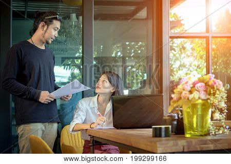 asian man and woman freelance working at home office