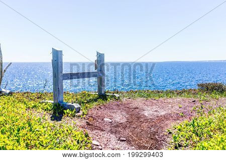 Trail Hiking In Bonaventure Island By Perce, Quebec In Gaspe, Gaspesie Region With Wooden Fence On E