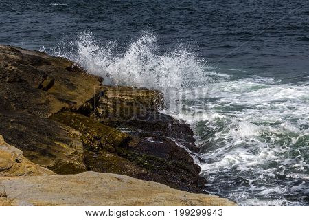 Waves crashing on rocky shore in Jamestown