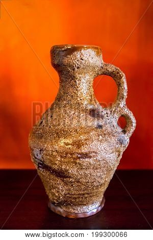 Antique aged vase on the table background