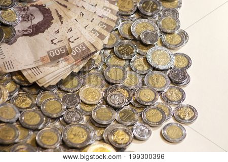 mexican pesos money, bills and coins background