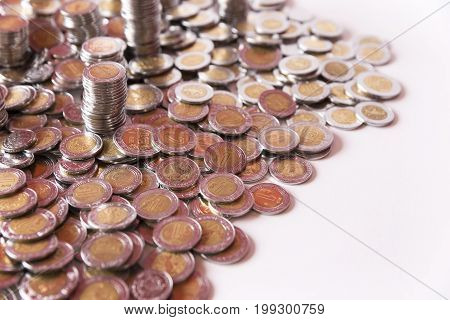 a lot of mexican pesos coins background