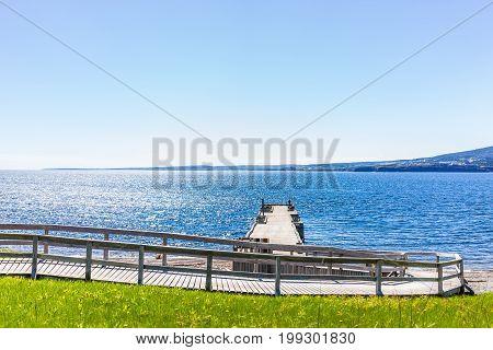 Bonaventure Island Park In Gaspe Peninsula, Quebec, Gaspesie Region With Dock Pier And View Of Perce