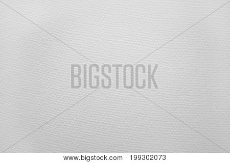 sheet of watercolor paper showing the rough textured surface