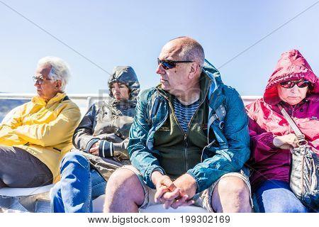 Perce Canada - June 6 2017: People tourists sitting on boat tour in Gaspe Peninsula Quebec Gaspesie region