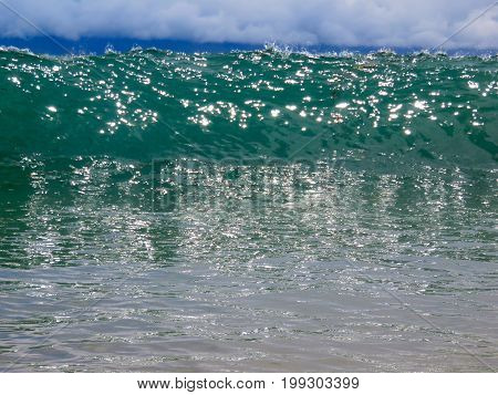 Incoming Turquoise Cresting Wave - Large Shore Break in Maui, Hawaii.
