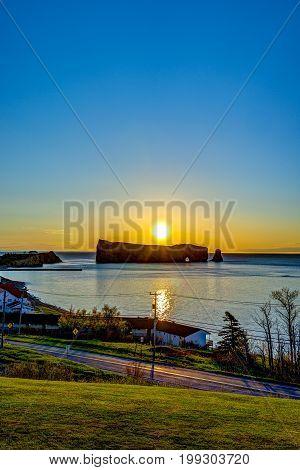 Famous Rocher Perce Rock In Gaspe Peninsula, Quebec, Canada, Gaspesie Region At Sunrise And Sun Path
