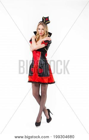 Red Queen cosplay - pretty young woman with long legs is posing, white background