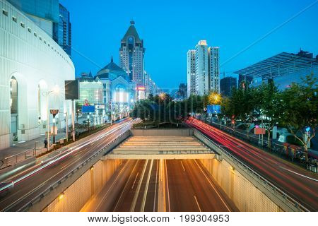 perspective view of downtown cityscape from footbridge,shanghai,china.