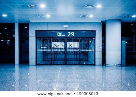 gate of airport terminal,blue toned,shanghai,china.