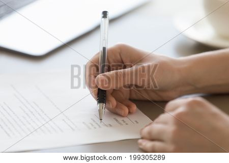 Businesswoman signing document concept, focus on female hand holding pen, putting signature on legal document, giving permission by authorization, subscribing contract, binding agreement, close up poster