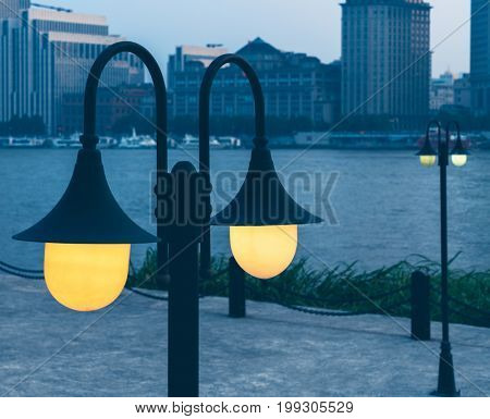 closeup of vintage lamps with modern buildings on background,tianjin,china.