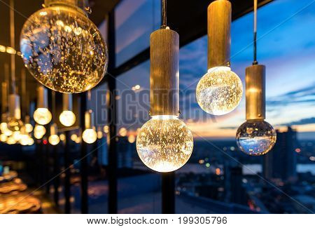 Luxury interiors of Chandelier Light pattern background at modern building
