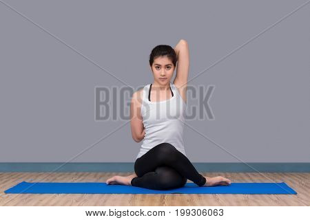 Asian Woman Practicing Yoga Pose At Sport Gym, Yoga And Meditation Have Good Benefits For Health. Ph