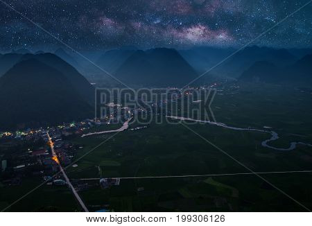Milky Way at Rice field in valley around with mountain panorama view in Bac Son valley, Lang Son, Vietnam