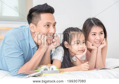 Asian Family Happy Smiling And Relax On Bed At Home In Holiday Vacation. Photo Series Of Family, Kid