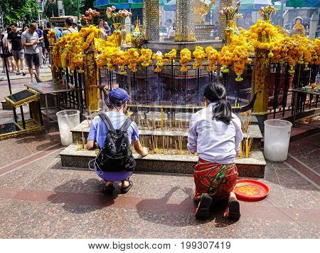 Praying At Erawan Temple In Bangkok, Thailand
