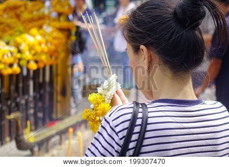 Praying At Erawan Temple In Bangkok, Thailand