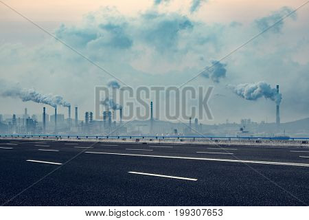 industrial factory with smoking chimneys against cloudy sky,shanghai,china.