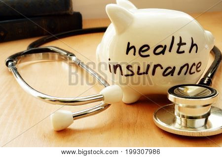 Piggy bank with words on a side health insurance.
