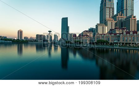 Tianjin city waterfront downtown skyline with Haihe river,China.