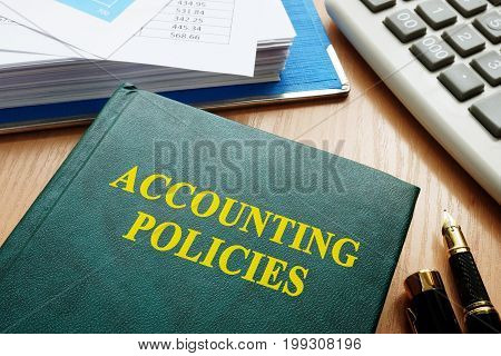 Book with title accounting policies on a table.