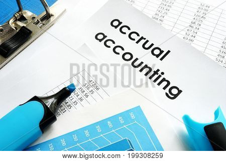 Accrual accounting document and marker on a table.