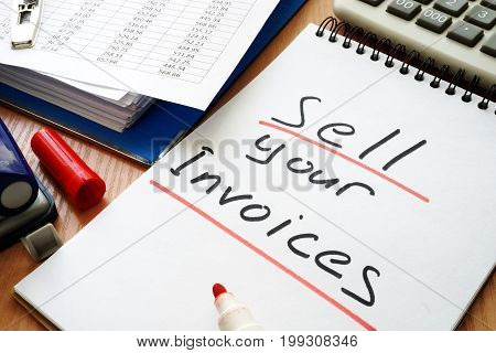 Note with sign sell your invoices. Business concept.