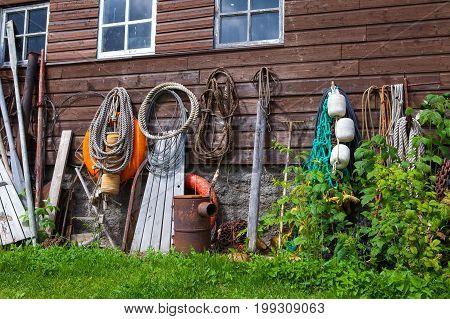 Fishing gear on the wall of wooden barn in Estonian fishing village