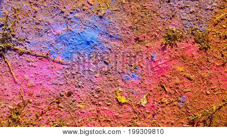 Creative Background Of Asphalt Surface With Scattered On It With Colored Powders. To Use As Backgrou