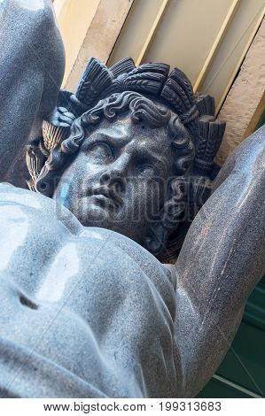 Granite Atlant which supports the portico of the building of the New Hermitage in St. Petersburg