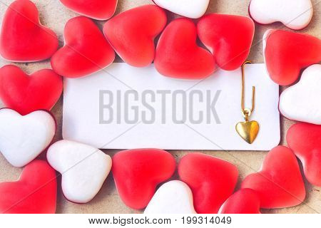 Sweet marmalade candy heart shape blank tag with paper clip and golden heart valentine day composition closeup image vintage style