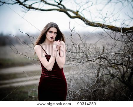 Attractive sad young girl in the field