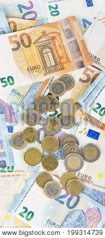 Money euro coins and banknotes bills. European currency money. Panormaic picture.