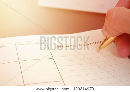 Hand writing blank planning notebook on desk use us organizer schedule life or business planner concept.