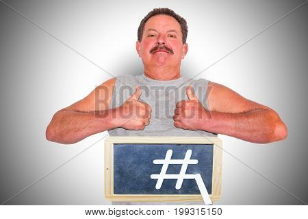 Man with black board and hash tag symbol. Hashtag symbol represents a viral concept for marketing blogging and trending web social media and network as well as internet topics.