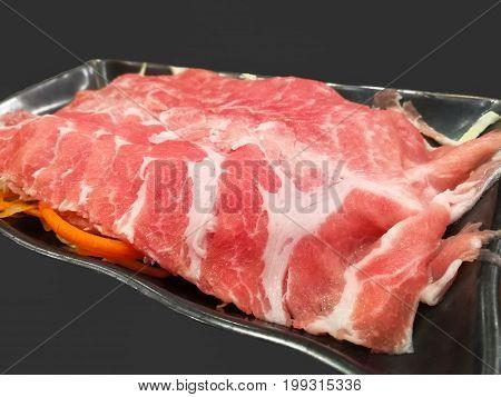 Sliced pork sliced On the black background