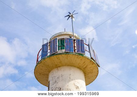 Tower of weather station with solar power and wind turbune