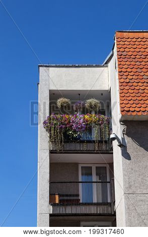 Modern house with tiled roof and balcony with greenery, Vilnius, Lithuania