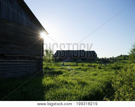 the old village with wooden houses in the lazy summer