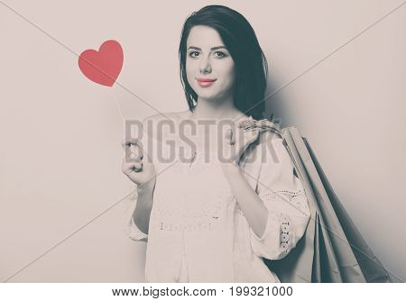 Portrait Of The Young Woman With Shopping Bags And Toy