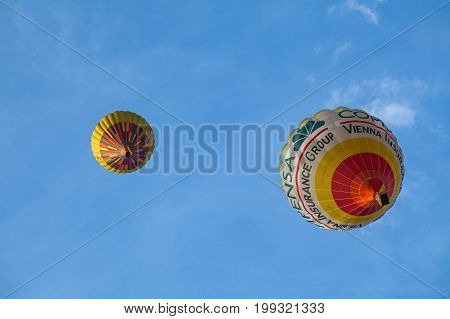 VILNIUS, LUTHUANIA - 22 AUG 2015: Two yellow Hot Air Balloon in the air under city