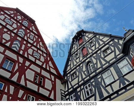 wo medieval half-timbered houses at the marketplace of Rothenburg ob der Tauber Germany Bavaria