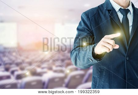 businessman hand touch virtual chart business Abstract blurred of conference hall or seminar room with attendee background double exposure.