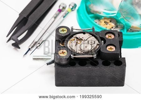 Holder With Watch And Tools For Repairing Watch
