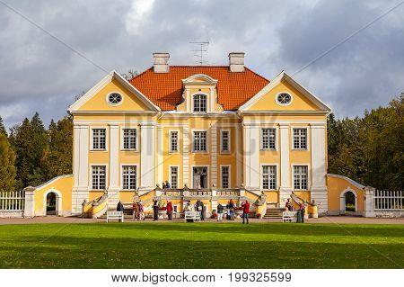 PALMSE, ESTONIA - 22 SEP 2015. Tourists walking in beautiful and rich Palmse Manor in Estonia