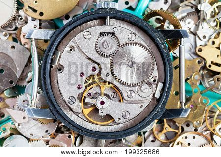 Open Vintage Wristwatch On Heap Of Spare Parts