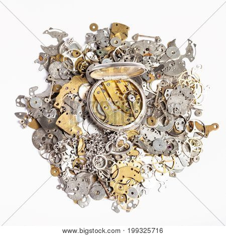Top View Of Pocket Watch On Heap Of Spare Parts