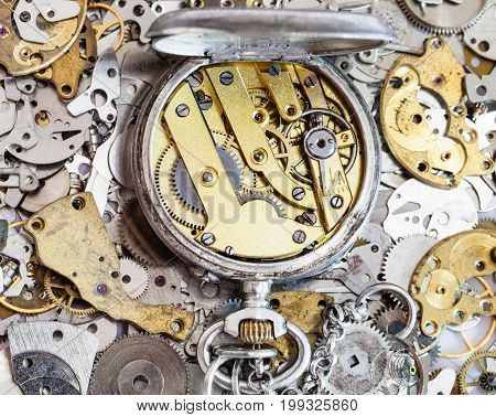 Open Used Pocket Watch On Pile Of Spare Parts