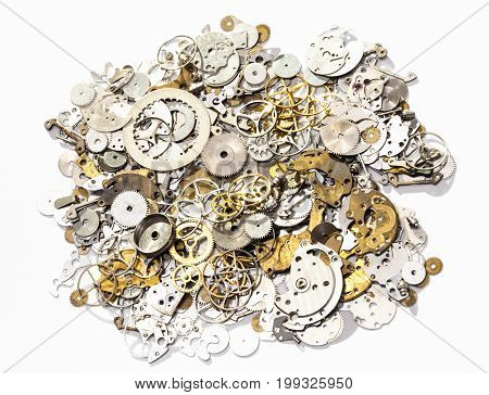 Heap Of Used Watch Spare Parts On White Background